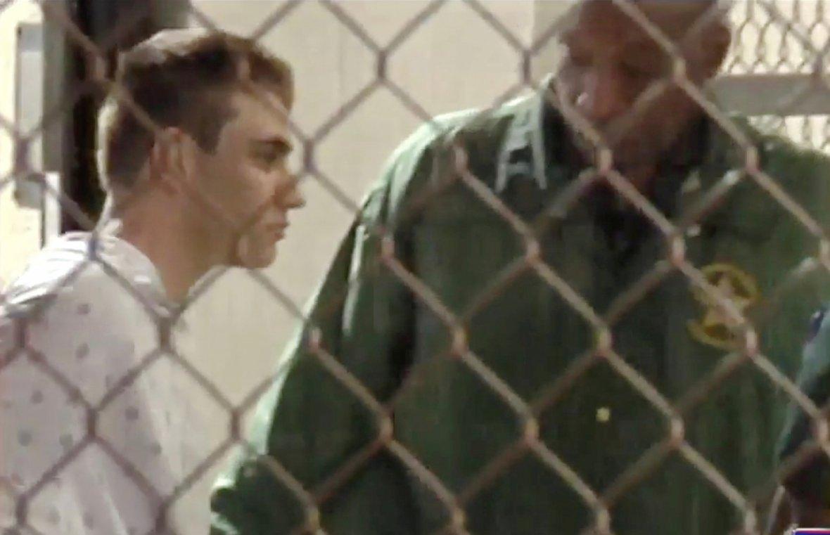 Police escort Nikolas Cruz into Broward County Jail following a shooting incident