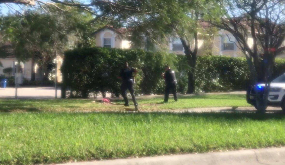 A man is approached by police officers, following a shooting incident in Parkland, Florida