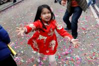 A child celebrates the Chinese Lunar New Year of the Dog in Manhattan's Chinatown in New York