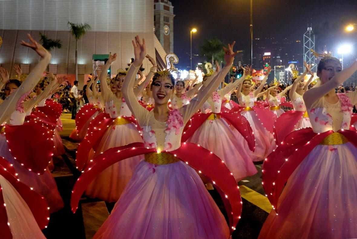 Dancers from China's Hainan perform during a parade to celebrate the Year of the Dog in Hong Kong