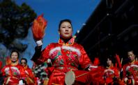 Members of the Chinese community celebrate the Lunar New Year of the Dog with a colourful parade