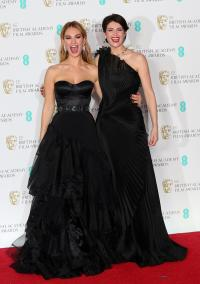Lily James and Gemma Arterton pose in the press room during the British Academy of Film and Television Awards (BAFTA)