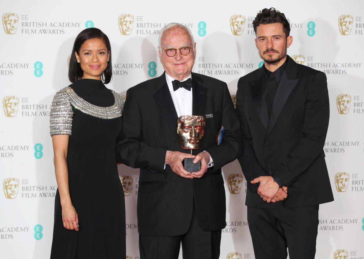 Presenters Orlando Bloom and Gugu Mbatha-Raw stand with James Ivory