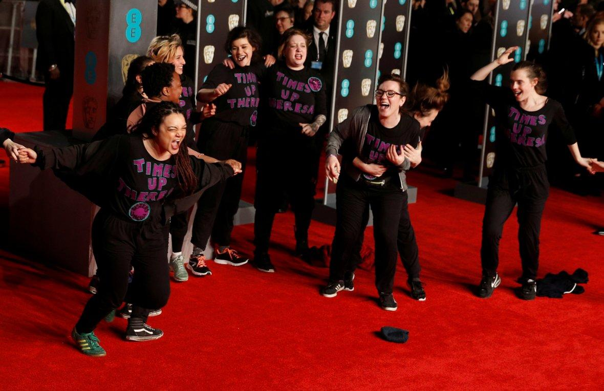 A group of protesters demonstrate on the red carpet at the British Academy of Film and Television Awards (BAFTA)
