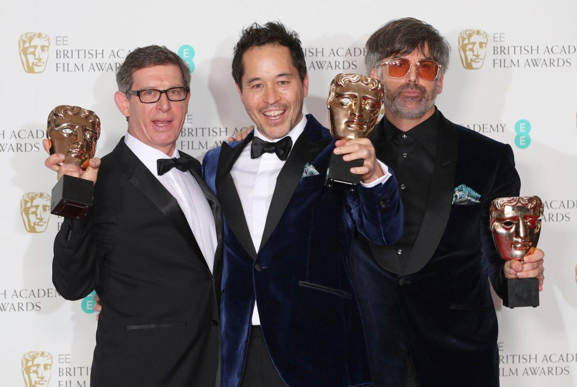 Jeff Melvin and Shane Vieau hold their awards for Production Design for the film The Shape of Water
