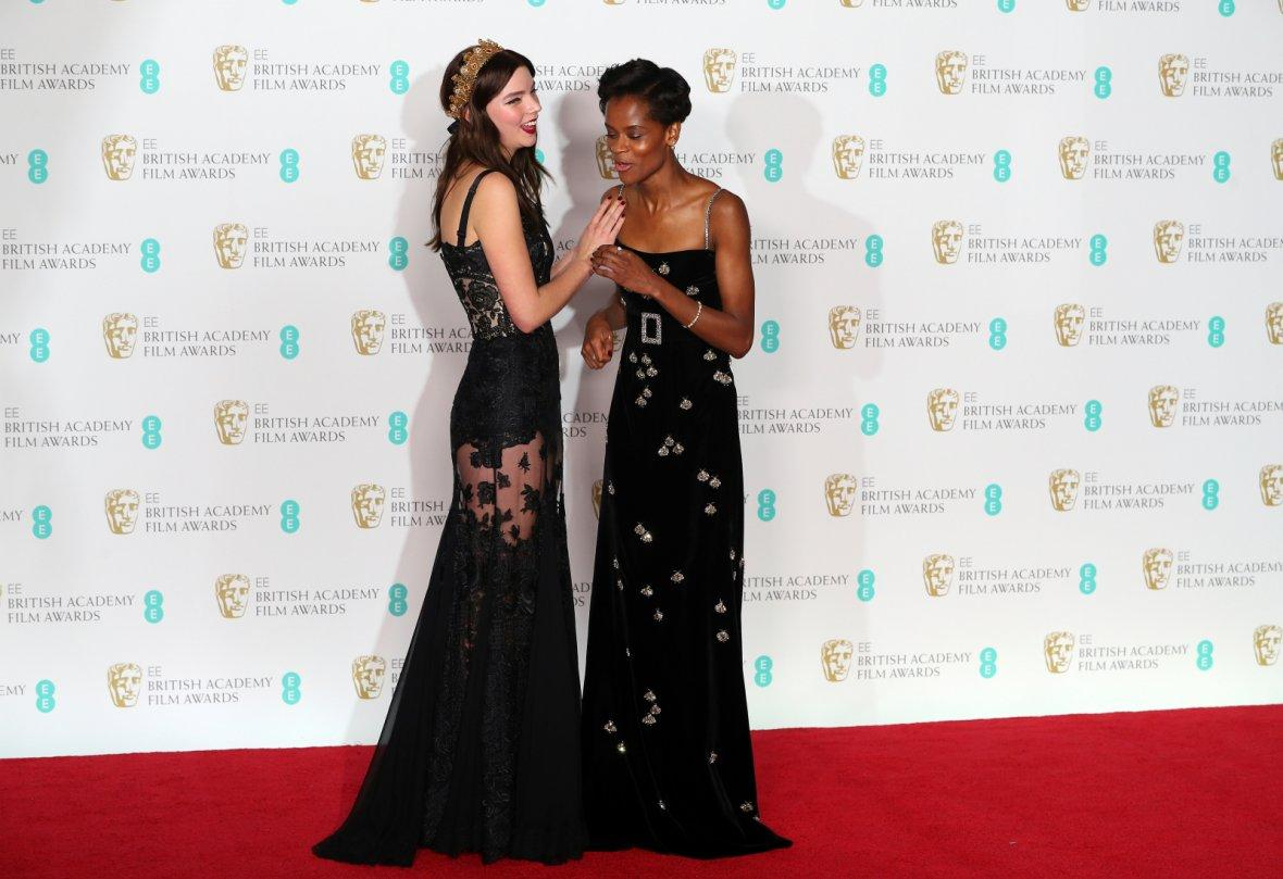 Presenters Letitia Wright and Anya Taylor Joy pose for pictures at the British Academy of Film and Television Awards (BAFTA)