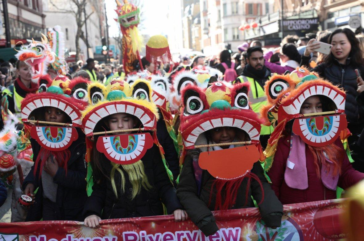 Performers dressed in traditional lion and dragon costumes take part in the Chinese New Year