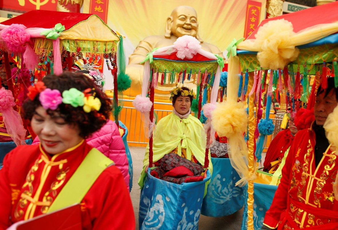 Performers wear costumes during Spring Festival celebrations marking Chinese New Year