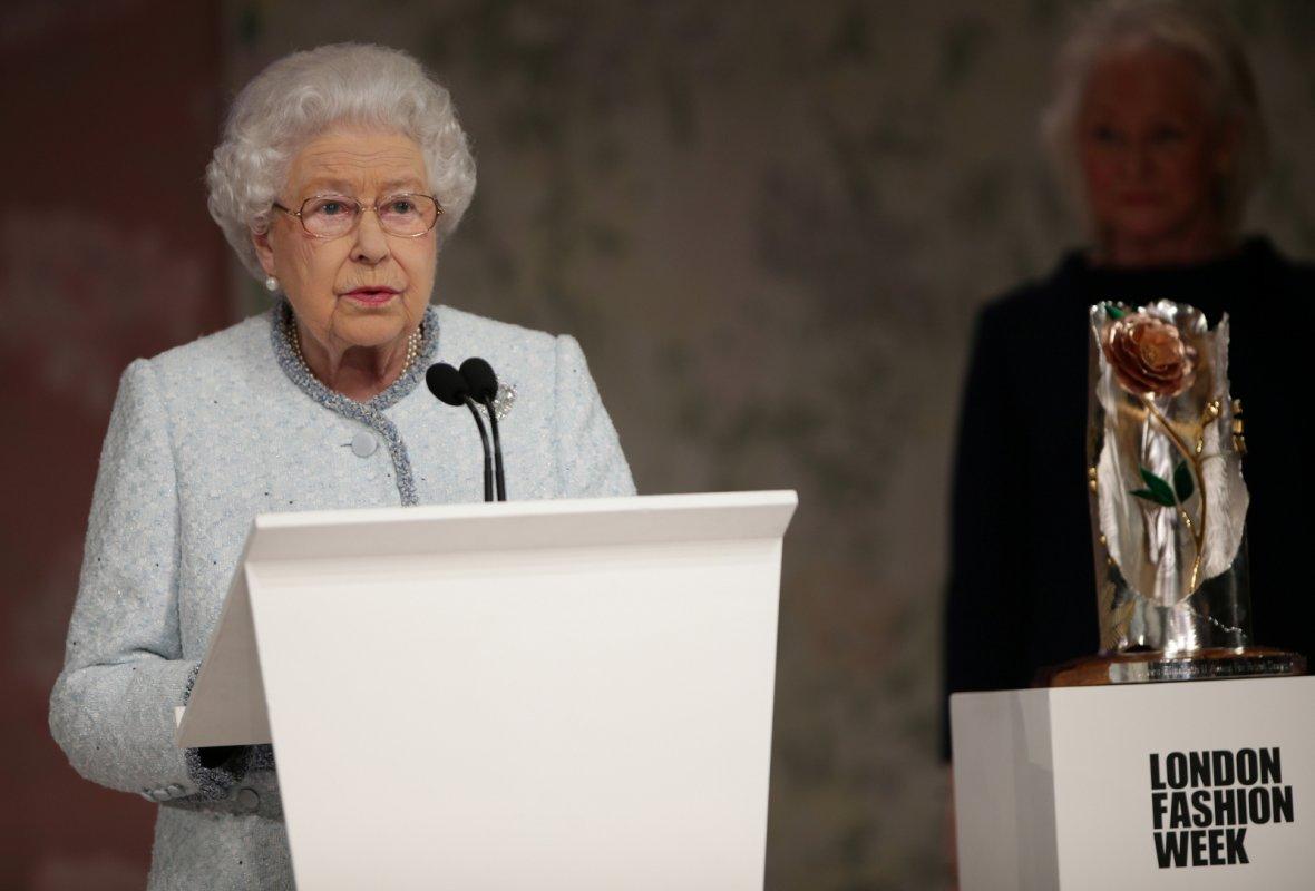 Britain's Queen Elizabeth II speaks before presenting Richard Quinn with the inaugural Queen Elizabeth II Award for British Design as she visits London Fashion Week