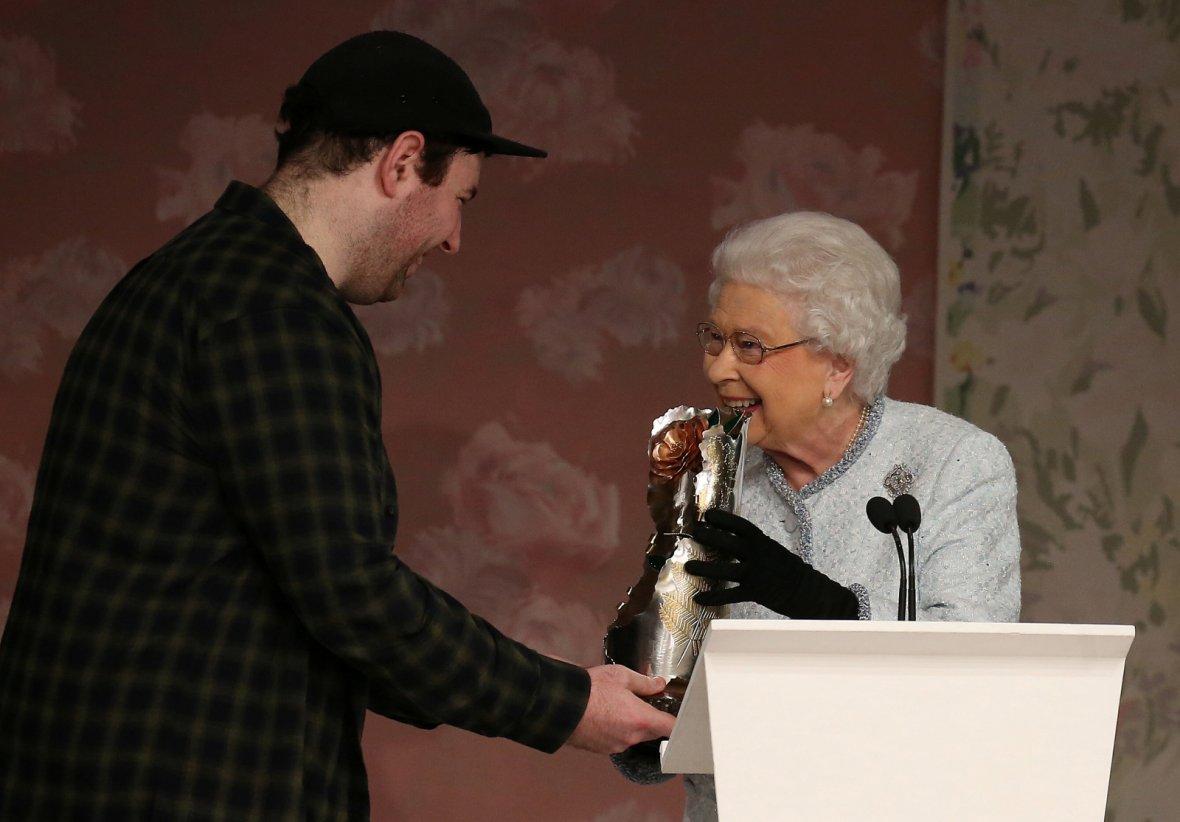 Britain's Queen Elizabeth II presents the inaugural Queen Elizabeth II Award for British Design to Richard Quinn