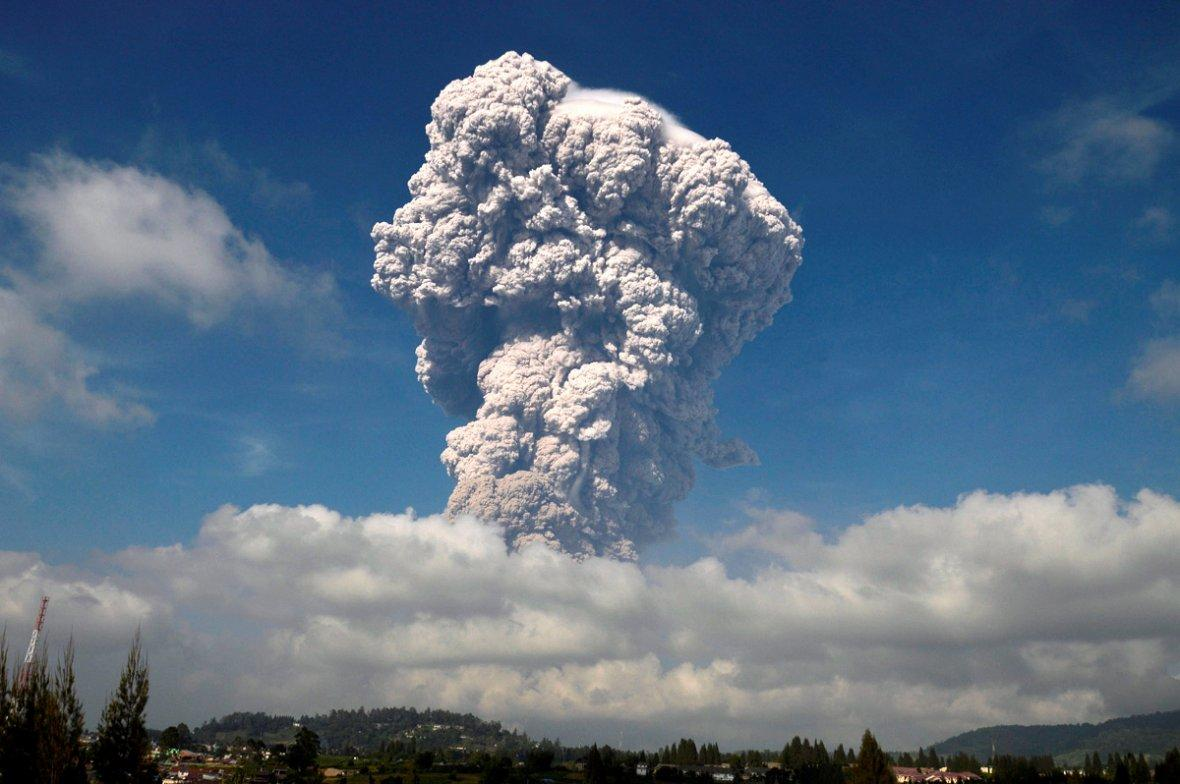 Ash from Mount Sinabung volcano rises during an eruption in Karo, North Sumatra, Indonesia