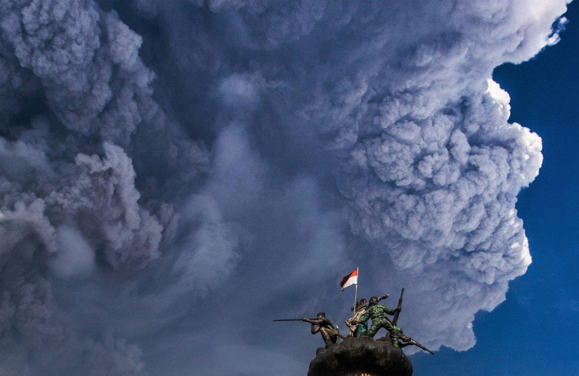 Ash from Mount Sinabung volcano rises during an eruption as seen from Brastagi town in Karo
