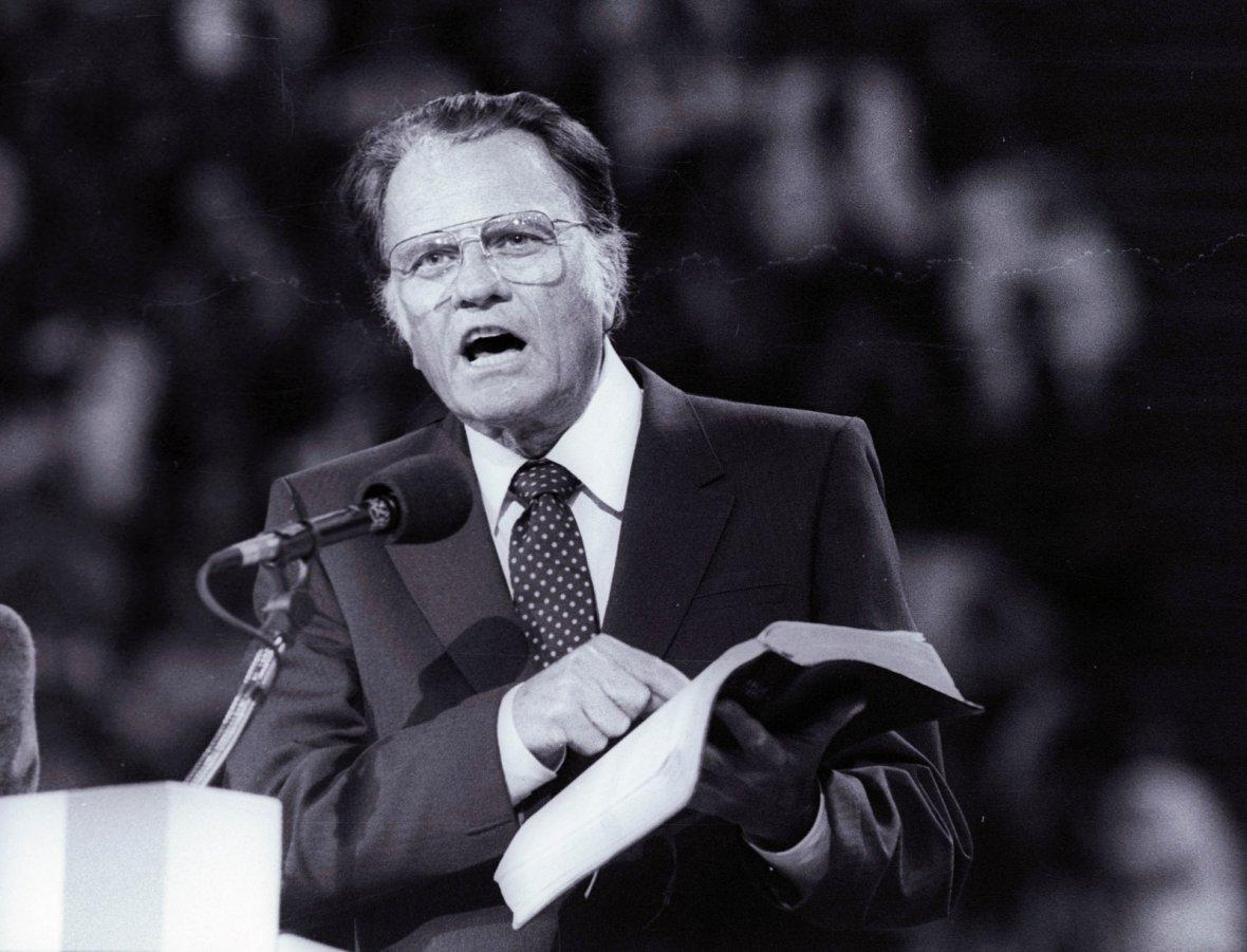 Billy Graham preaches the Gospel to thousands of believers in Paris as part of a worldwide crusade in 1986