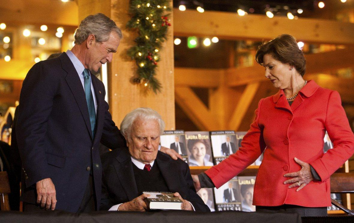 Former President George W. Bush gives a copy of his book Decision Points to Billy Graham