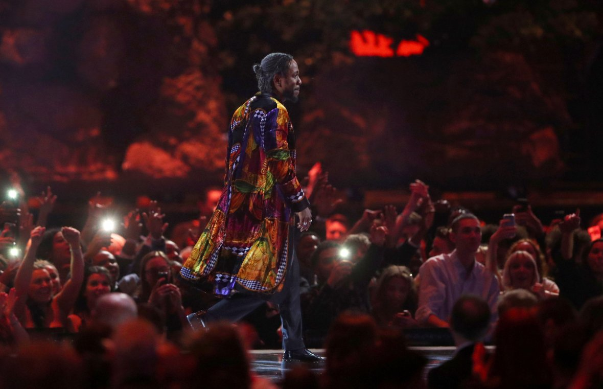 Kendrick Lamar accepts the award for international solo male artist at the Brit Awards