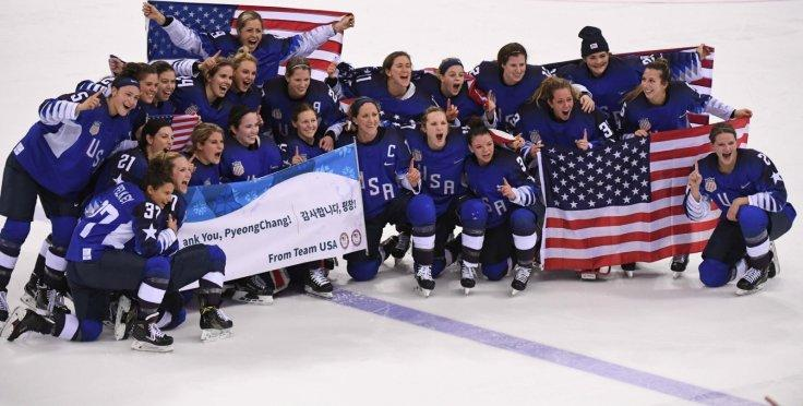 Team USA pose for group photos after winning women's ice hockey final against Canada at Gangneung Hockey Centre