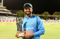 Suresh Raina of India poses with the Man of the Match trophy during post match presentation ceremony at the Newlands Cricket Ground in Cape Town, South Africa on Feb 24, 2018.