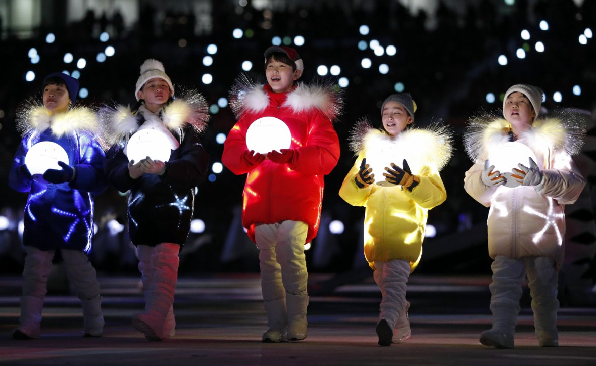 Volunteers participate in winter olympic closing ceremony