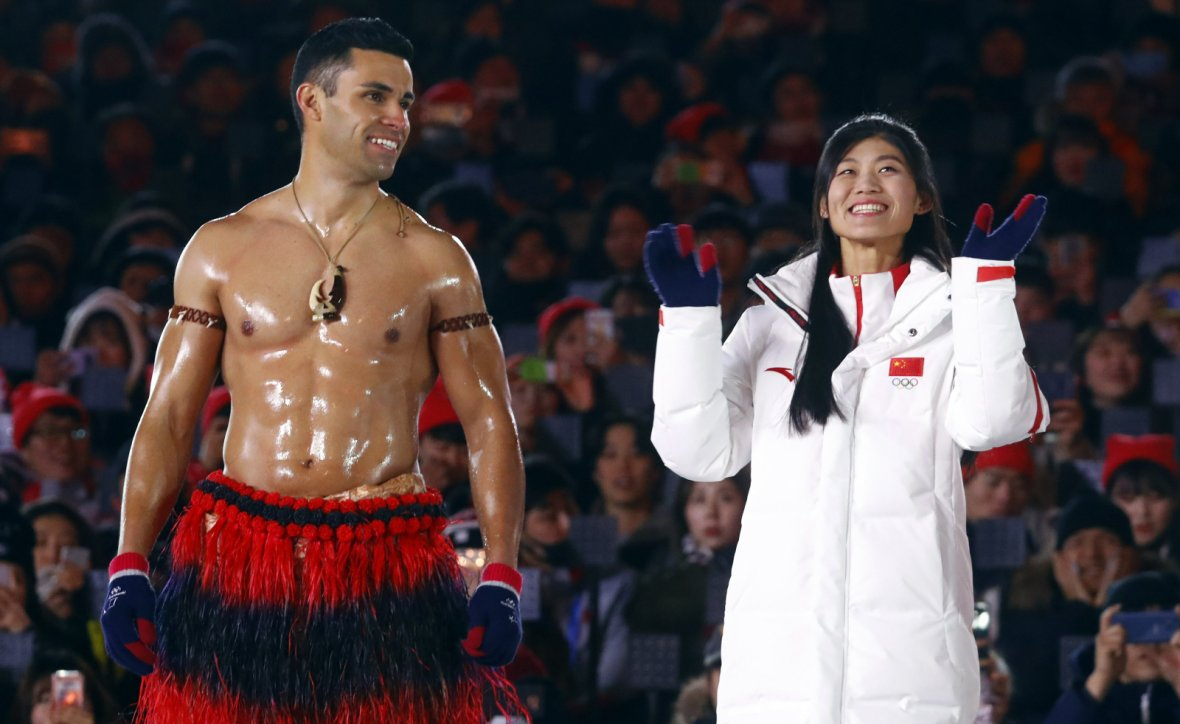 Pita Taufatofua of Tonga and Liu Jiayu of China during the closing ceremony