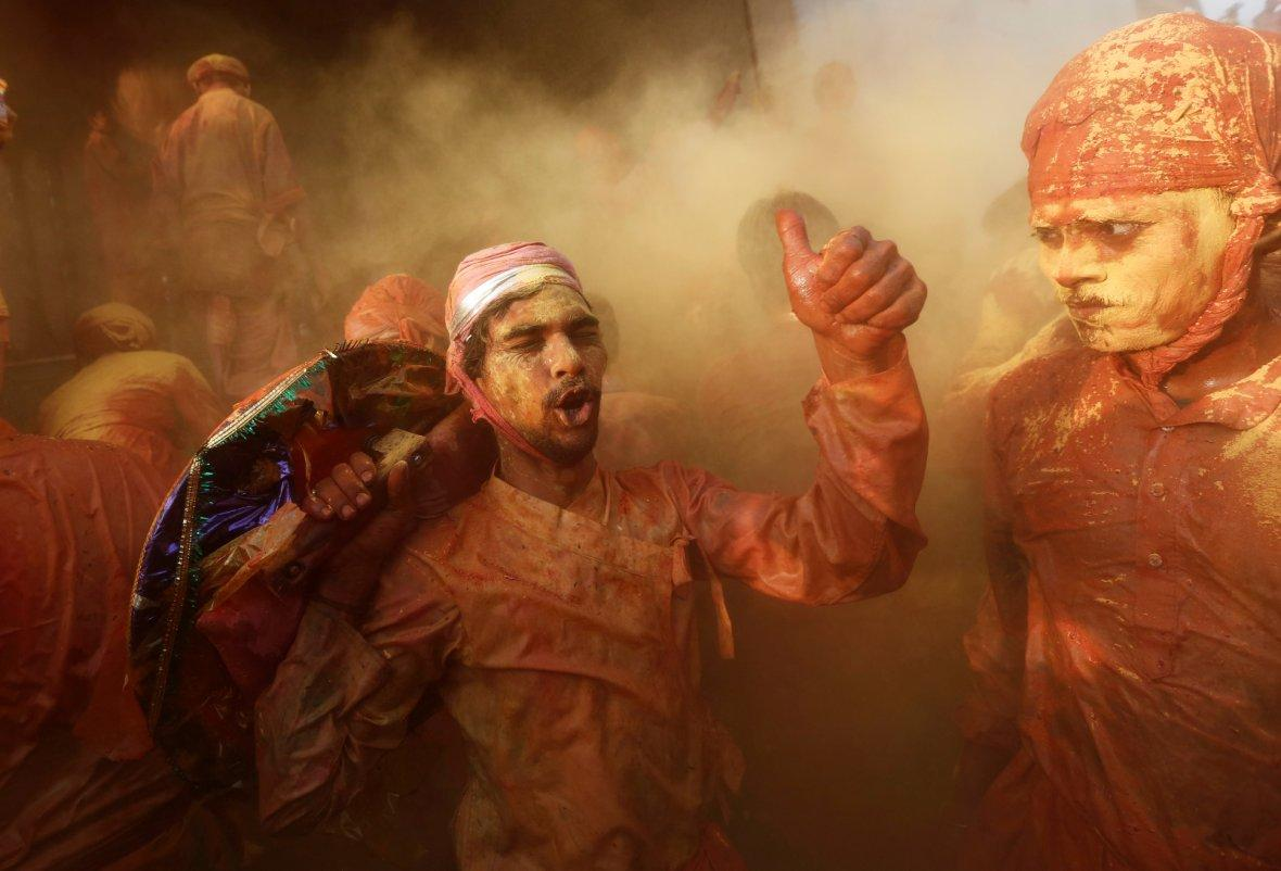 Hindu devotees take part in the religious festival of Holi