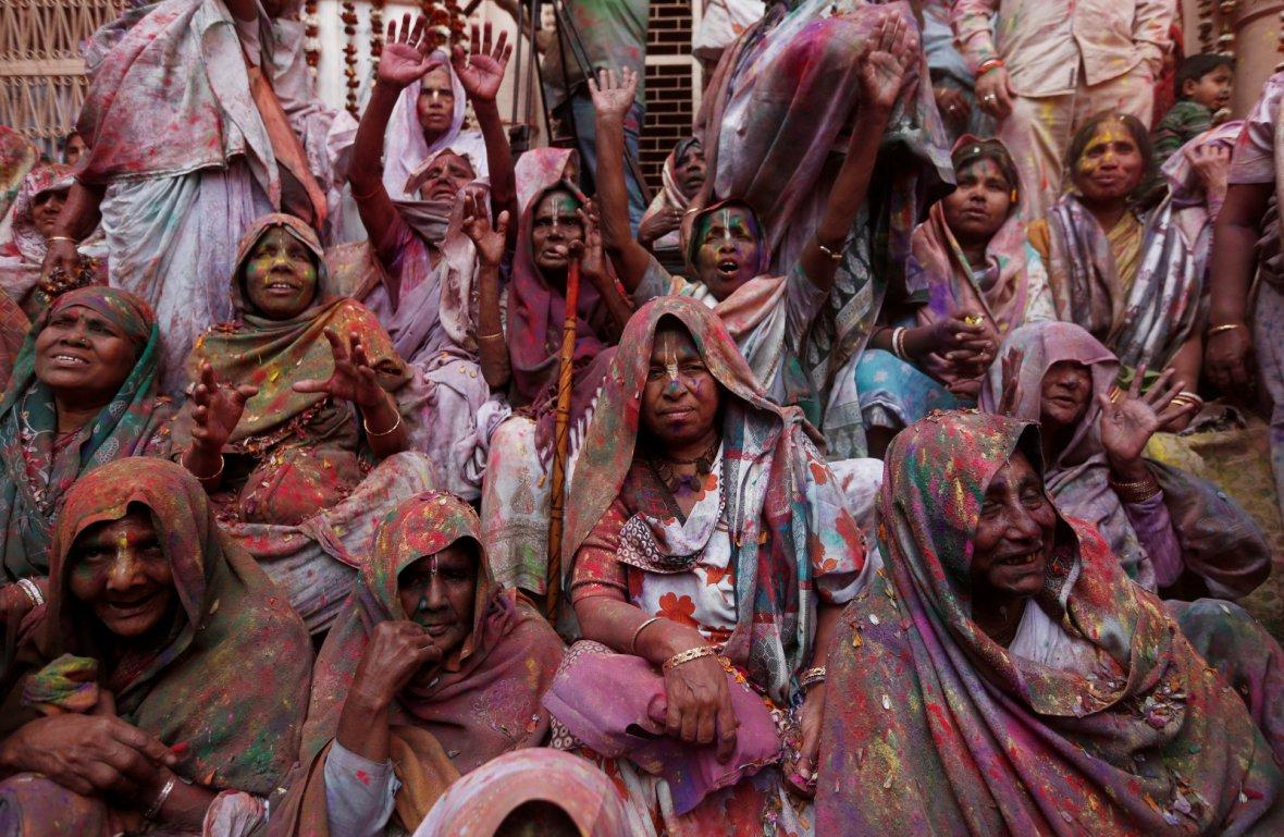 Widows daubed in colours take part in Holi celebrations