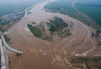 Heavy rainfall and flood in China kills at least 87, thousands evacuated