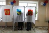 VLADIVOSTOK, March 18, 2018 (Xinhua) -- Voters write ballots at a polling station in Vladivostok, east Russia, March 18, 2018. Russia held presidential election on Sunday. (Xinhua/Denis/IANS)