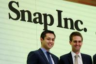 Snap cofounders Evan Spiegel (R) and Bobby Murphy wait to ring the opening bell of the New York Stock Exchange (NYSE) shortly before the company's IPO in New York