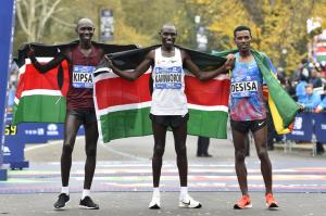 (From left to right) Wilson Kipsang and Geoffrey Kamworor and Lelisa Desisa poses for a photo following the Professional Men's division race at the 2017 TCS New York City Marathon.