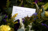 A floral tribute left outside Great St Marys Church, where the funeral of theoretical physicist Prof Stephen Hawking is being held, in Cambridge, Britain, March 31, 2018.