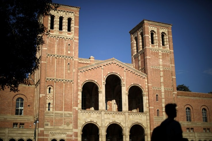 A student walks past Royce Hall on the University of California Los Angeles (UCLA) campus