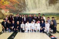 North Korean leader Kim Jong Un poses with South Korean K-pop singers in this photo released by North Korea's Korean Central News Agency (KCNA) in Pyongyang April 2, 2018.