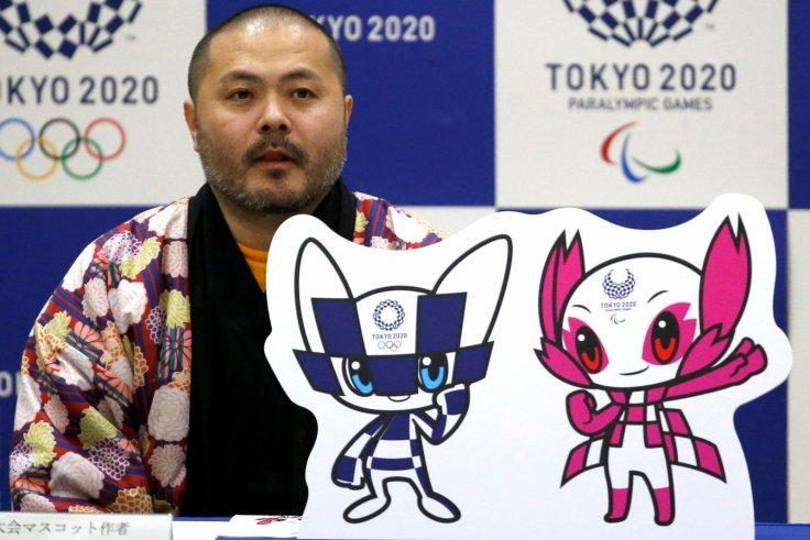 The designer of winning mascots Ryo Taniguchi attends a news conference after Tokyo Olympics organizers unveiled the mascots for the Tokyo 2020 Olympics and Paralympics selected by popular vote by elementary students across Japan at the Hoyonomori Gakuen