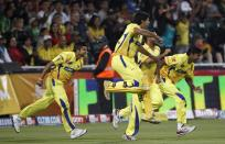 Chennai Super Kings players celebrate their win over the Warriors during their final Twenty20 cricket match in Johannesburg September 26, 2010.
