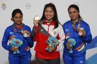 Shooting - Gold Coast 2018 Commonwealth Games - Women's 10m Air Rifle - Final - Belmont Shooting Centre - Brisbane, Australia - April 9, 2018. Gold medallist Martina Lindsay Veloso of Singapore, silver medallist Mehuli Ghosh of India and bronze medallist