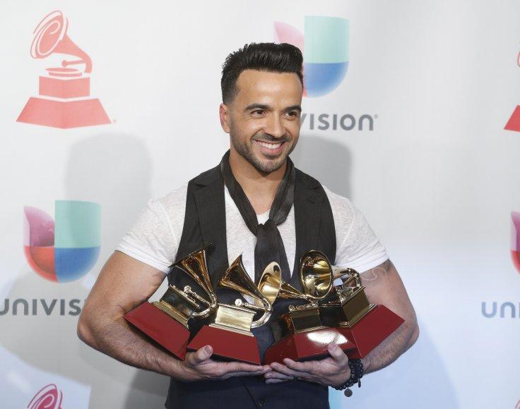 "Luis Fonsi holds his awards for Song of the Year, Record of the Year and Best Long Form Music Video for ""Despacito"" and Best Urban Fusion/Performance for ""Despacito (Remix)""."