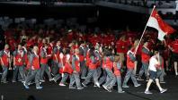 Gold Coast 2018 Commonwealth Games - Closing Ceremony - Carrara Stadium - Gold Coast, Australia - April 15, 2018. Kean Yew Loh of Singapore carries the national flag