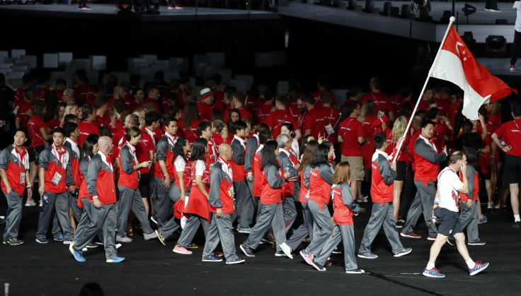Gold Coast 2018 Commonwealth Games - Closing Ceremony - Carrara Stadium - Gold Coast, Australia - April 15, 2018. Kean Yew Loh of Singapore carries the national flag