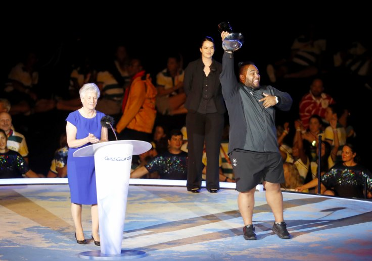 Gold Coast 2018 Commonwealth Games - Closing ceremony - Carrara Stadium - Gold Coast, Australia - April 15, 2018 - President of the Commonwealth Federation Louise Martin awards the athlete of the games, David Liti of New Zealand.