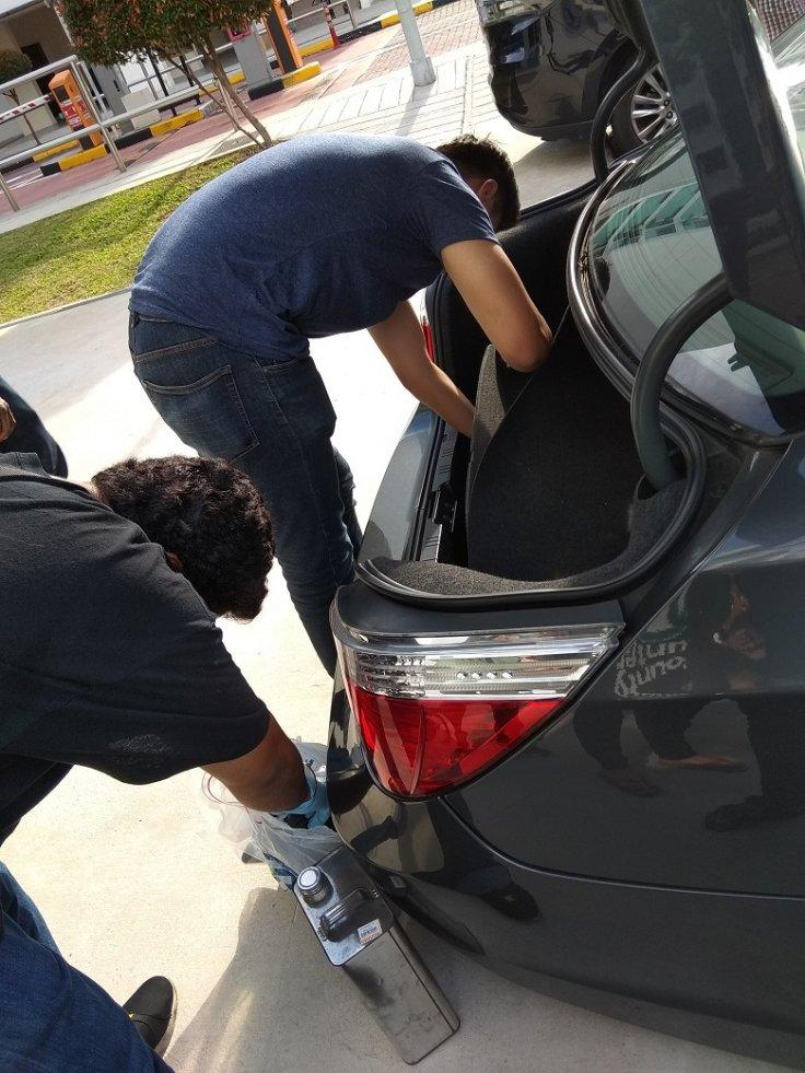 CNB officers conducting a search of a suspect's car, during CNB's 11-day island-wide operation from 16 to 27 April 2018.