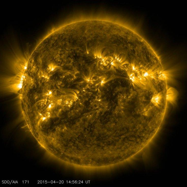 Bright spots and illuminated arcs of solar material hovering in the sun's atmosphere highlight what's known as active regions on the sun, in this image from NASA's Solar Dynamics Observatory, captured on April 20, 2015. These are areas of intense and comp