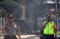 Police are seen outside the Immaculate Santa Maria Catholic Church following a blast, in Surabaya, East Java, Indonesia May 13, 2018 in this photo taken by Antara Foto. Antara Foto/M Risyal Hidayat / via REUTERS ATTENTION EDITORS - THIS IMAGE WAS PROVIDED