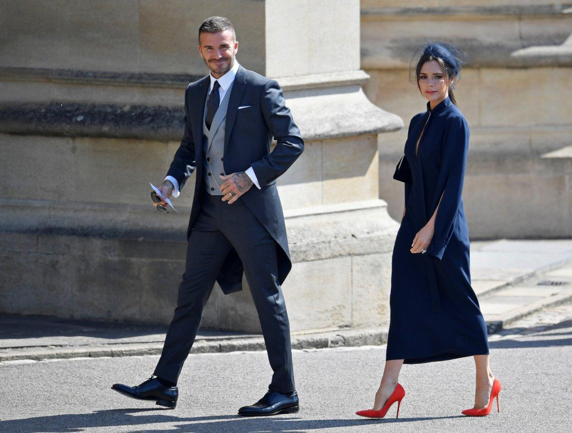 David and Victoria Beckham arrive to the wedding of Britain's Prince Harry to Meghan Markle in Windsor,