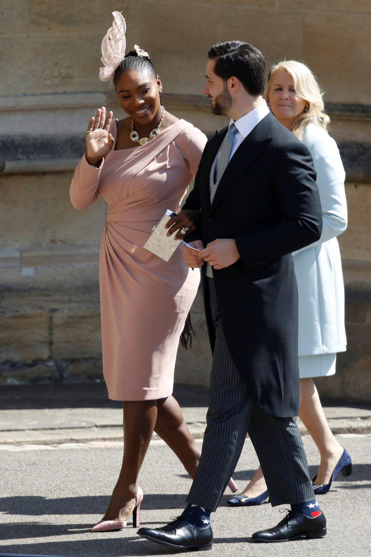 Meghan Markle's friend, US tennis player Serena Williams (L) and her husband US entrepreneur Alexis Ohanian (R) arrive for the wedding ceremony