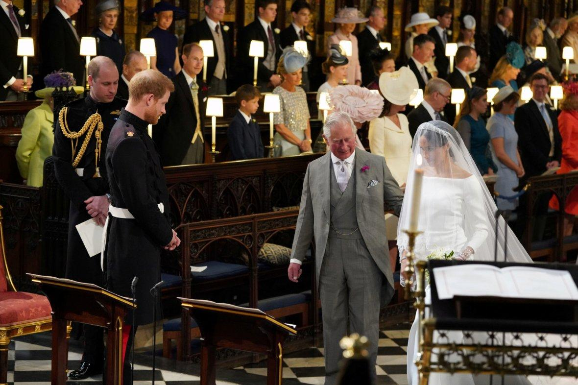 Prince Harry looks at his bride, Meghan Markle, as she arrives accompanied by the Prince of Wales in St George's Chapel at Windsor Castle for their wedding in Windsor,