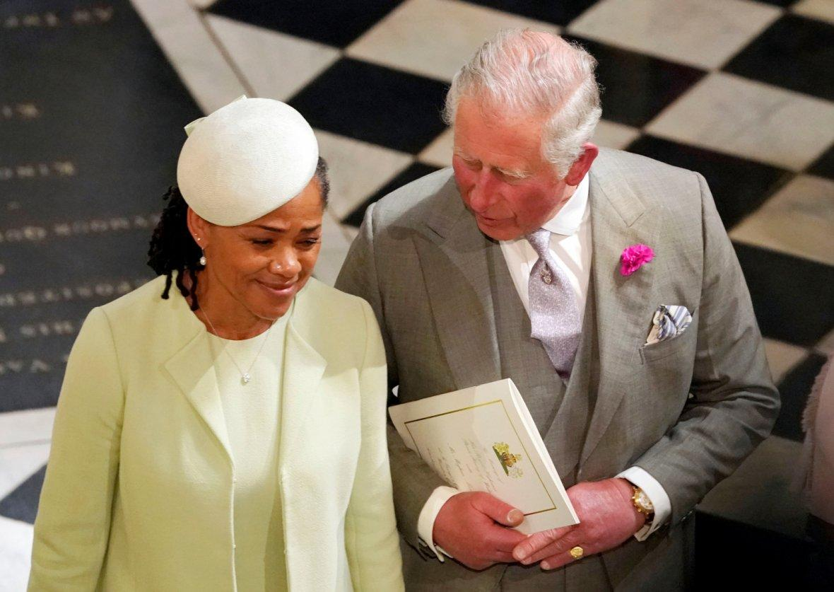 The Prince of Wales and Doria Ragland, mother of the bride, depart from St George's Chapel in Windsor Castle after the wedding of Prince Harry and Meghan Markle in Windsor