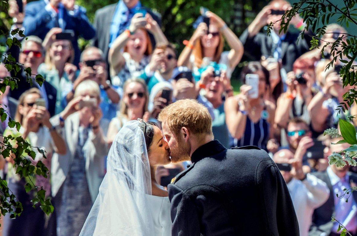 Meghan Markle and Prince Harry kiss on the steps of St George's Chapel at Windsor Castle following their wedding