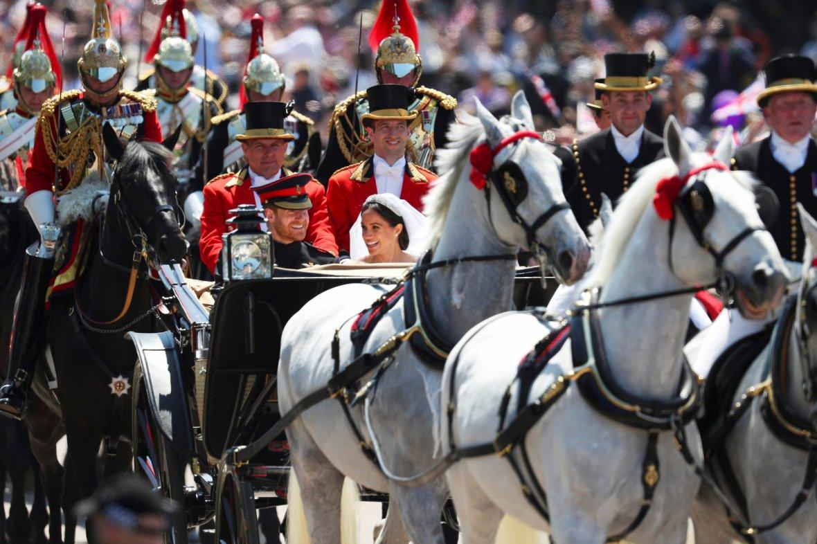 Prince Harry, Duke of Sussex and the Duchess of Sussex in the Ascot Landau carriage during the procession