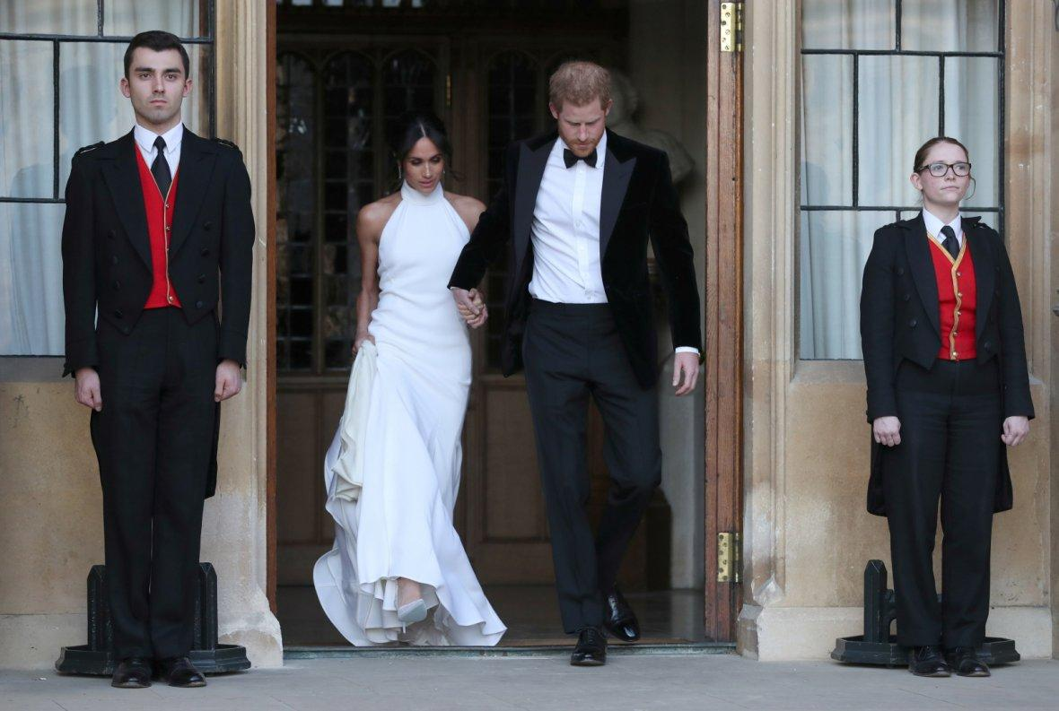 The newly married Duke and Duchess of Sussex, Meghan Markle and Prince Harry, leaving Windsor Castle after their wedding to attend an evening reception at Frogmore House, hosted by the Prince of Wales Windsor,