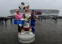 Russian Football Championship - FC Rostov vs FC Ural - Rostov Arena, Rostov-on-Don, Russia - May 13, 2018 Fans pose with the official mascot for the 2018 FIFA World Cup Zabivaka outside the stadium before the match.